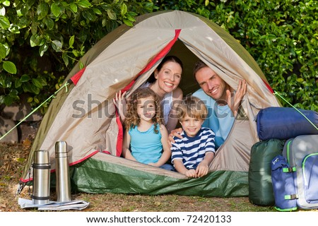 Joyful family camping in the garden - stock photo