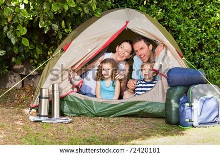 Joyful family camping in the garden - stock photo