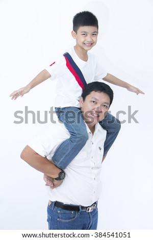 Joyful father giving piggyback ride to his son against a isolated on white background - stock photo