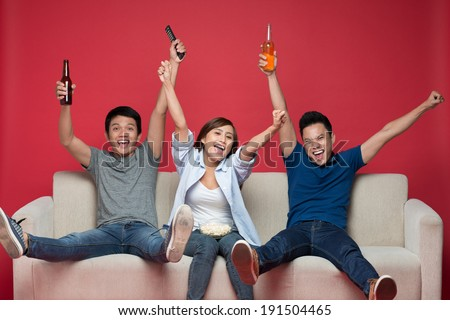Joyful friends cheering - stock photo