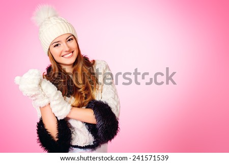 Joyful girl in warm knitted clothing smiling at camera. Beauty, fashion. Winter lifestyle. Copy space. - stock photo