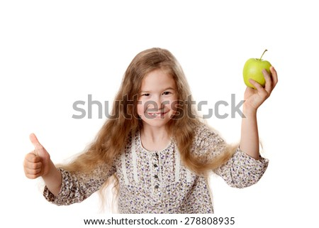 joyful girl with apple shows a great gesture! - stock photo