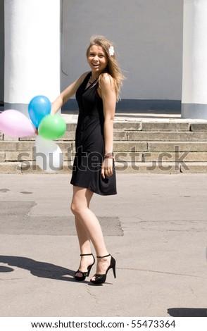 Joyful girl with balloons - stock photo