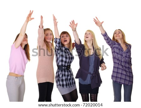 joyful girls reaching for something at the top - stock photo