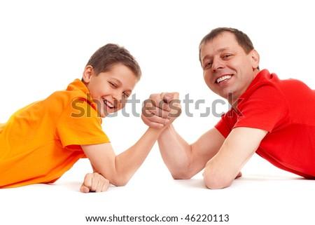 joyful guys playing arm wrestling - stock photo