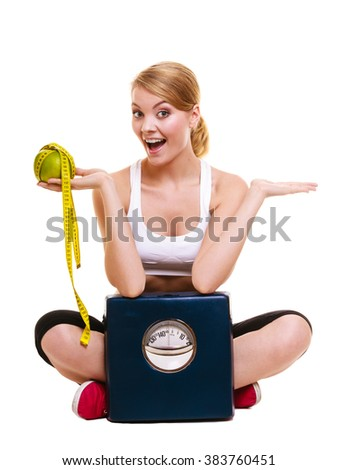 Joyful happy woman girl holding grapefruit, measurement tape and weighing scale showing empty hand copy space. Fitness and healthy lifestyle concept. Dieting and slimming. Isolated on white background - stock photo