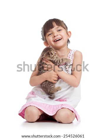 joyful kid girl holding kitten isolated on white