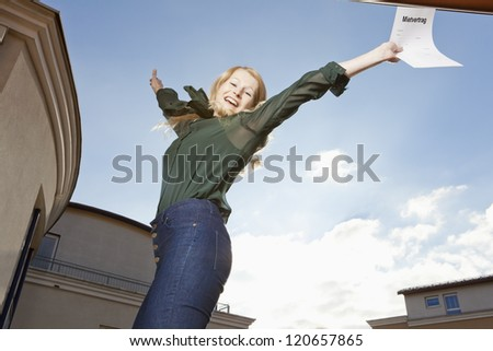 Joyful leap of a young woman with rental agreement