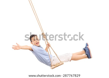Joyful little boy swinging on a swing and gesturing happiness isolated on white background - stock photo