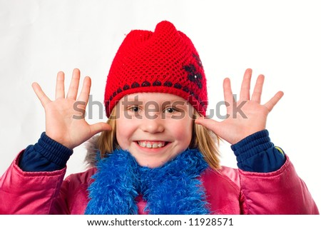 joyful little girl dressed winter clothes - stock photo