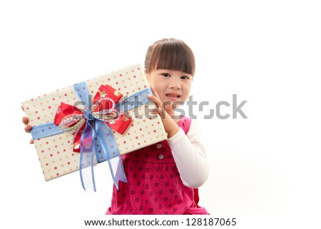 Joyful little girl holding present in hands - stock photo