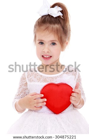 Joyful little girl in a summer white dress, presses his hands to his chest heart. Closeup-Isolated on white background