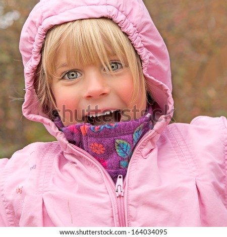 Joyful Little Girl Outside in Autumn - stock photo