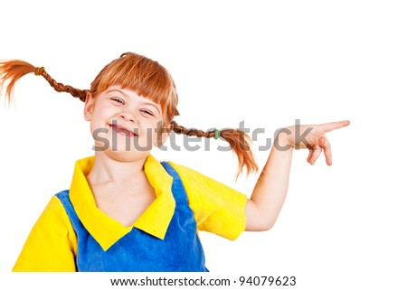 Joyful little girl pointing to the side - stock photo