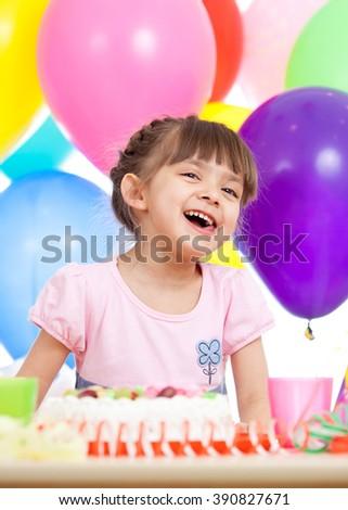 Joyful little kid girl at birthday party - stock photo