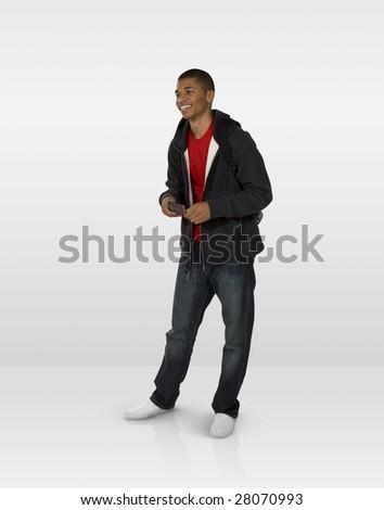 Joyful male teen using mobile phone - stock photo