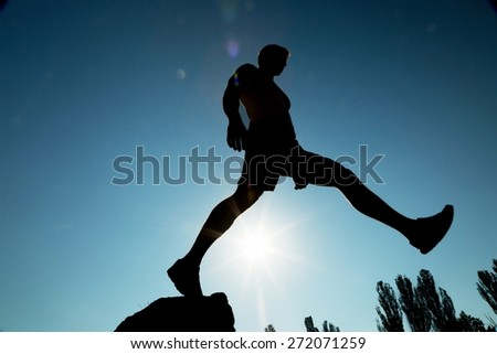 Joyful. Man jump through the gap. Element of design. - stock photo