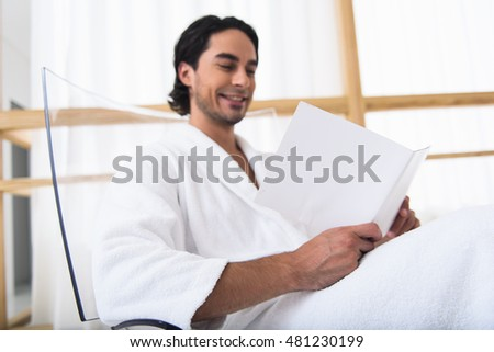 Joyful man relaxing at wellness center