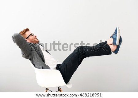Joyful man resting in the chair