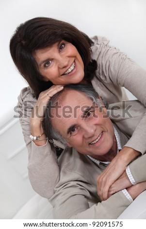 Joyful mature couple - stock photo