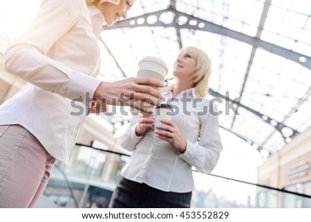 Joyful mother and daughter talking in store - stock photo