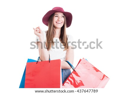 Joyful pretty woman having a great idea at shopping and carrying colorful gift bags isolated on white - stock photo