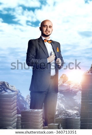 joyful rich businessman in a suit with a bunch of money. Business concept - stock photo