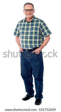 Joyful senior man posing casually with hands in pocket isolated on white - stock photo