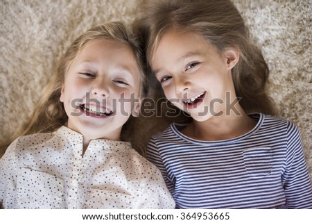 Joyful sisters having fun together
