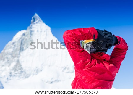 Joyful ski vacation on the background beautiful mountains and blue sky
