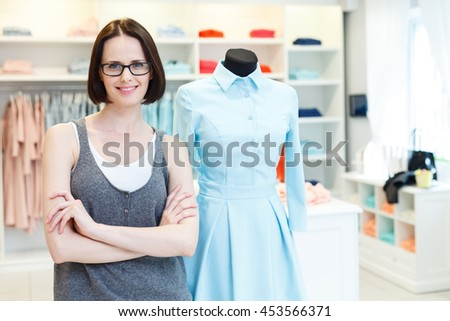 Joyful tailor working in atelier - stock photo