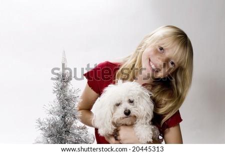 Joyful Tweenster celebrating Christmas with her new Best Friend - stock photo