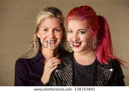 Joyful white female parent and child indoors - stock photo