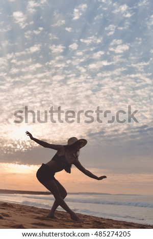 Joyful woman dancing in the sunset on beach background outdoors. Book cover design idea concept