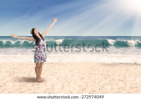 Joyful woman enjoying freedom. shoot on the beach - stock photo