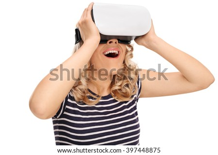 Joyful woman experiencing virtual reality through VR headset isolated on white background