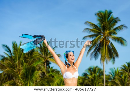 Joyful woman having fun and snorkeling at tropical caribbean beach vacation. Healthy leisure and sport on vacation concept. - stock photo