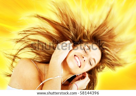 Joyful woman listening to music with eyes closed isolated over a yellow background - stock photo