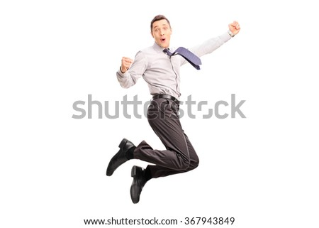Joyful young businessman jumping and gesturing happiness shot in mid-air isolated on white background - stock photo