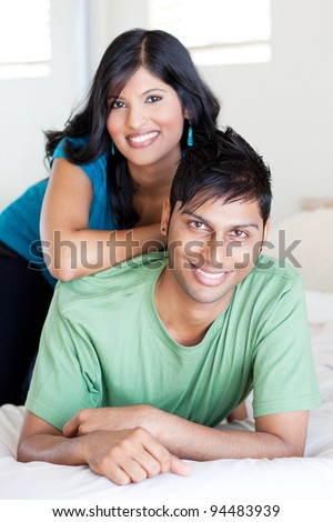 joyful young indian couple portrait - stock photo