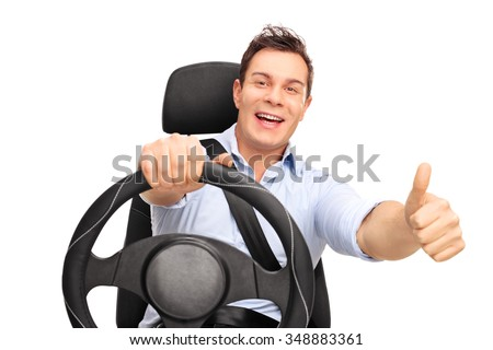 Joyful young man driving and giving a thumb up isolated on white background - stock photo