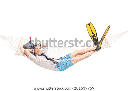 Joyful young man with diving equipment lying in a hammock and looking at the camera isolated on white background - stock photo