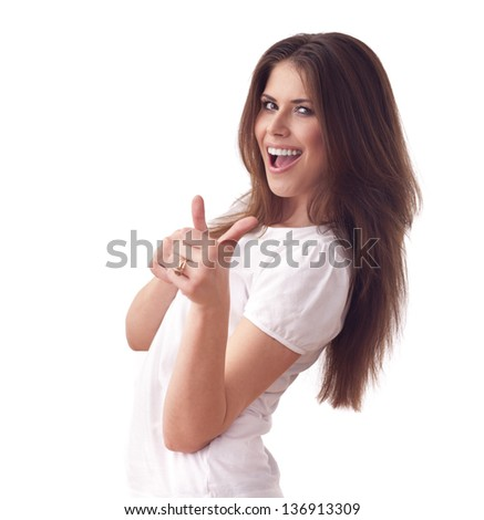 Joyful young woman in t-shirt showing thumbs up. isolated on white background
