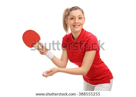 Joyful young woman playing table tennis and looking at the camera isolated on white background - stock photo