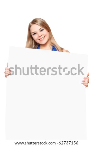 Joyful young woman posing with white board. Isolated