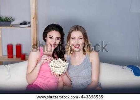 Joyful young women having fun together - stock photo