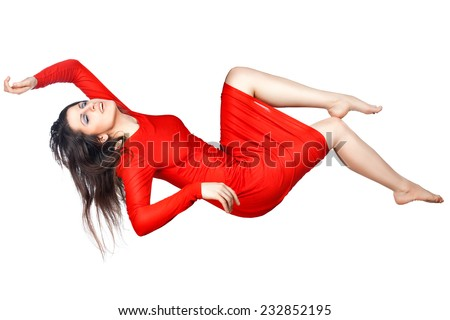 Joyfully smiling woman flies outstretched arms and legs, she on a white background. - stock photo