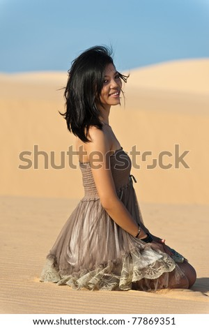 Joyous young woman in dunes - stock photo