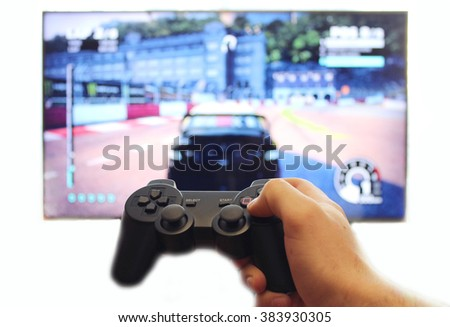 Joystick for video game consoles in the hands - stock photo