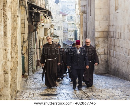 JRUSALEM OLD TOWN, ISRAEL - OCTOBER 31, 2014: Unidentified Fathers from Franciscan Order on traditional Friday Via Dolorosa (way of sorrows) procession.  - stock photo